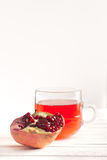 Half a ripe pomegranate and transparent glass and with juice Royalty Free Stock Photos