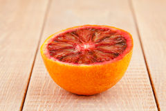 Half of ripe red blood orange Stock Images