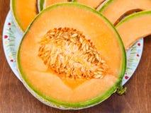 Half of ripe sicilian cantaloupe melon close up Royalty Free Stock Photos