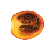 Half of a ripe tamarillo fruit isolated Stock Images
