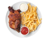 Half roasted chicken and french fries Stock Images