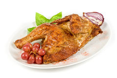 Half roasted chicken at plate Stock Photos