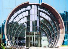 Half rounded glazed entrance with rotating door in modern skyscraper, closeup stock photo