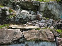 Half-ruined old wall masonry with moss. Texture, stonework royalty free stock image