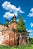 Dilapidated Orthodox Church made of red bricks, Russia. Stock Photo