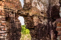 Half ruined red brick wall fragment Royalty Free Stock Photo