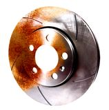 Half Rusted Sport Brake Disc. Sport brake disc, half eaten by rust Royalty Free Stock Images