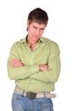 Half Serious Young Man Posing Cross Hands Stock Photography