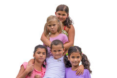 Half sister sad in gypsy family. Brother and sisters children in gypsy family hugging white unhappy girl Royalty Free Stock Photos