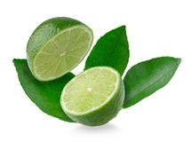 Half with slice of fresh green lime isolated on white background.  royalty free stock photography