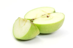 Half and slice green apple Royalty Free Stock Images