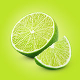 Half and slice of lime citrus fruit Stock Images