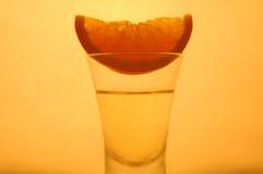 Half slice of orange. A shot of half slice of orange on vodka Royalty Free Stock Images