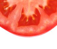Half slice of tomato isolated Royalty Free Stock Photography