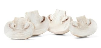 Half sliced champignons on white isolated background. Close-up. royalty free stock image
