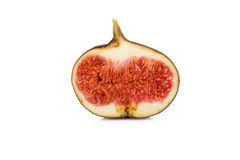 Half sliced fig on white Royalty Free Stock Photos