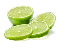 Half and sliced lime. Work with texture and form. Close-up. stock image