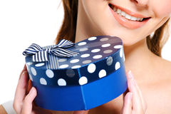 Half smiling face of  female  holding the blue box Stock Image
