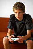 Half smiling video game player Royalty Free Stock Images