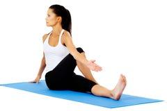 Half spinal stwist stretch Stock Photo