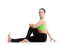 Half Spinal Twist yoga pose Royalty Free Stock Images