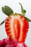 Half strawberry on strawberry ice cream. On a white background Stock Photo
