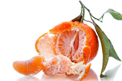 Half of a tangerine with leaf Stock Images