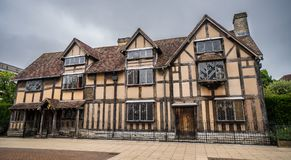 Half-timbered beauty, Shakespeare`s birthplace with cloudy dark skies. royalty free stock image