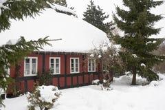 Half-timbered Haus im Schnee Stockbild