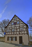 Half-timbered house on blue sky background. Stock Photo