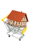 Half-timbered house in the cart. Half-timbered house in the shopping cart icon photo for home purchase, financing, cost Stock Images
