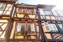 Half timbered house 4. Half timbered house in Colmar city, Alsace France, with sun rays Royalty Free Stock Photo