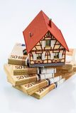 Half-timbered house on euro banknotes Stock Image