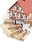 Half-timbered house on euro banknotes Stock Photography