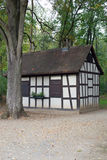 Half timbered house in forest Stock Images