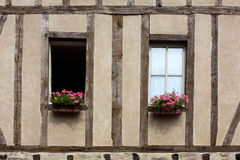 Half-timbered house in France. Picture of a half-timbered farm and centered on two windows. Picture taken in the Loire region Stock Photos