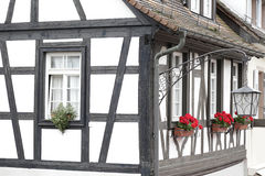 Half-timbered house, Germany. Detail of a typical half-timbered house with brown frame located in Gengenbach, Germany Stock Image