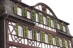 Half-timbered house with green windows Germany royalty free stock image