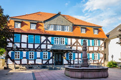 Half-timbered house. Grunberg, Hesse, Germany. Fountain and half-timbered house in the old town of Grunberg. Hesse, Germany stock image