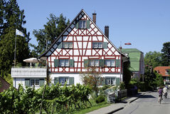 Half-timbered house on the Lake Constance. Half-timbered house on the shore of Lake Constance in the wine village Nonnenhorn near Lindau Stock Images