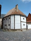 Half-timbered house in Quedlinburg. This is a unique half-timbered house as it uses vertical uprights (Standerbau). It dates back from the 14th Century and is stock photography