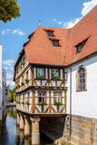 Half Timbered House on a River in Forchheim Stock Image