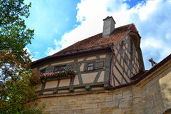 Half-Timbered House on City Wall Stock Images