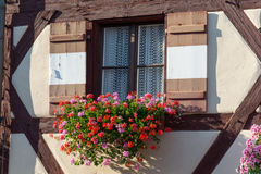 Half-timbered house with window shutters and flowers Royalty Free Stock Photos