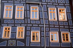 Half-timbered house with yellow windows Royalty Free Stock Photography