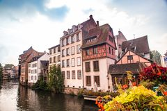 Half-timbered houses and canal seen from Strasbourg France stock photography