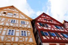 Half-timbered houses in hirschhorn. Three beautiful old timber-framed houses under blue cloudy sky royalty free stock image