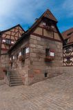 Half-timbered in Nuremberg, Germany. View of the tower of Nuremberg Castle and half-timbered buildings, Germany Stock Photography