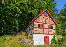 Half-timbered. Old half-timbered building under tall trees Stock Photos
