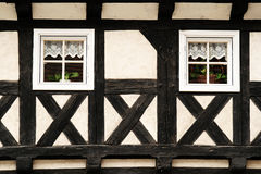 Half-timbered wall with two windows Stock Image